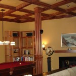 Basement game room with coffered ceiling